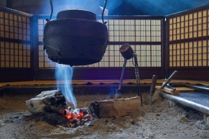 E4P76B Indoor Cooking Fire and Pot in Traditional Japanese House